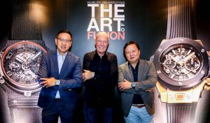 Lucerne Managing Directors Emerson Yao and Ivan Yao with Hublot Chairman Jean-Claude Biver