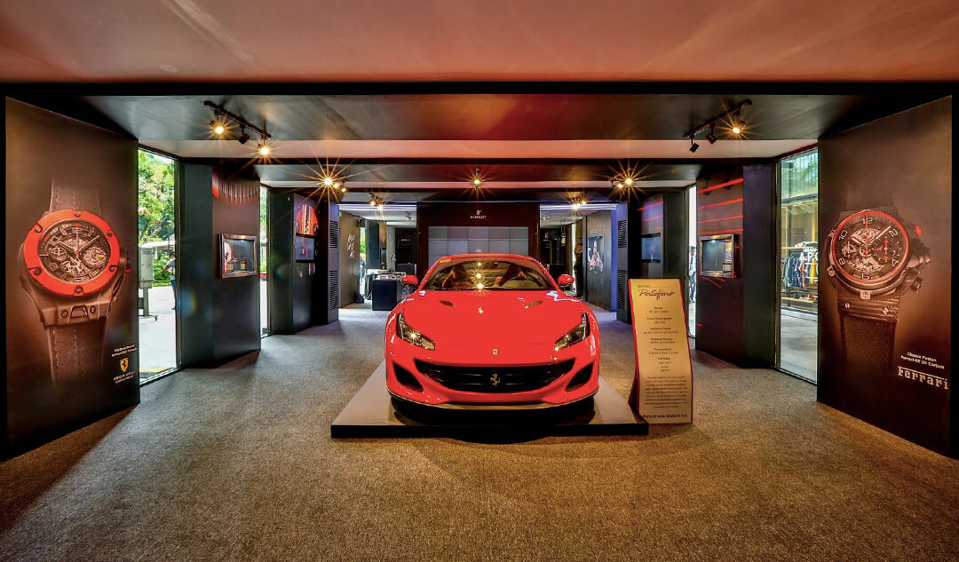A Ferrari Portofino welcomes guests in the Hublot Art of Fusion Exhibit