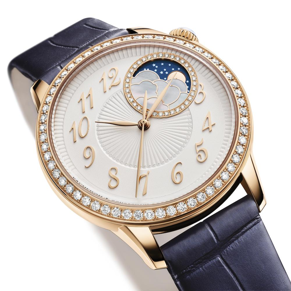 The Vacheron Constantin Égérie Moon Phase in 18K 5N rose gold with a dark blue strap.